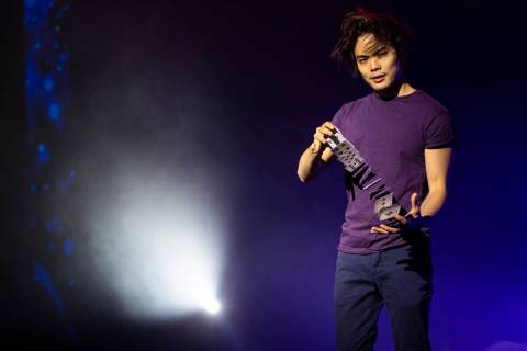"""Illusionist Shin Lim poses for a portrait onstage ahead of the reopening of his show, """"Lim ..."""