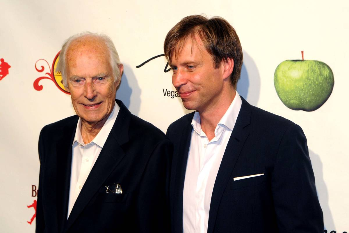 Music producers Sir George Martin, left, and son Giles Martin arrive for the fifth-anniversary ...