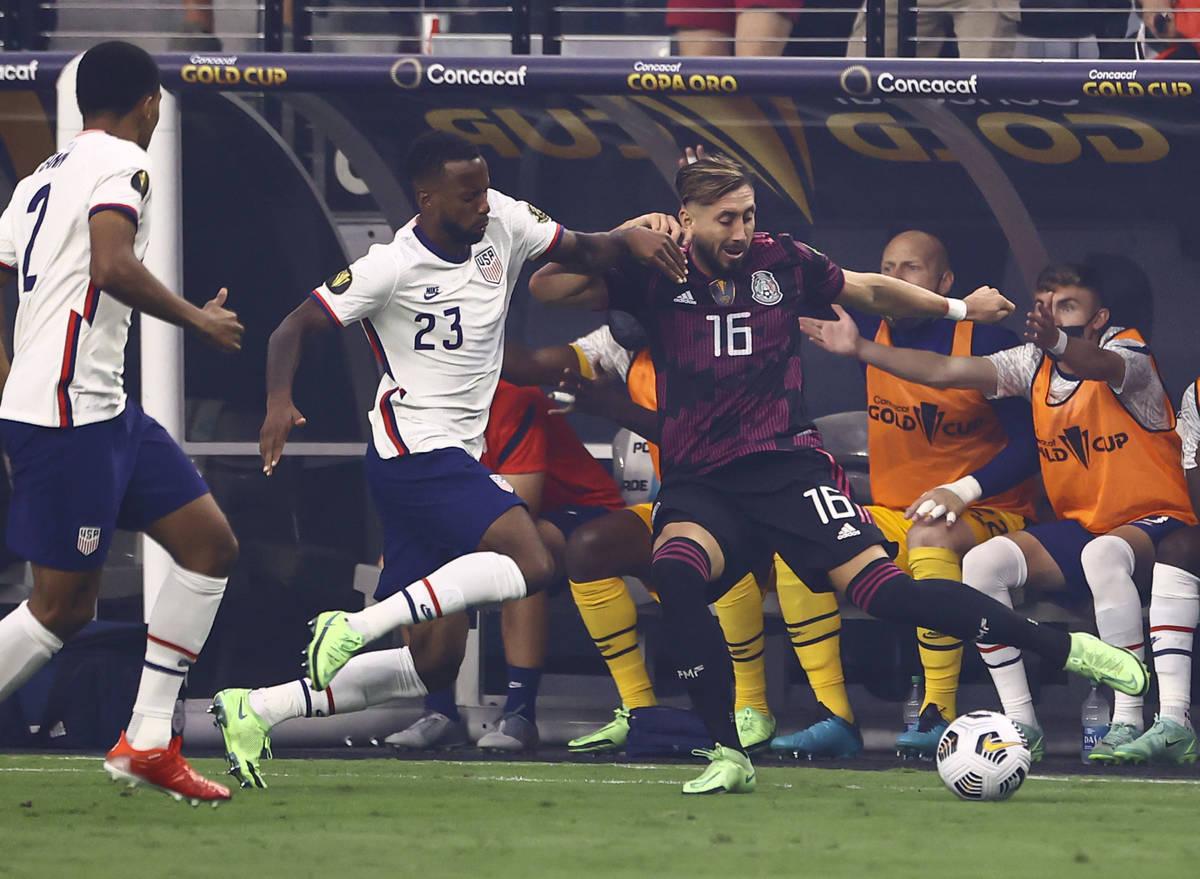 Mexico midfielder Hector Herrera (16) moves the ball around United States midfielder Kellyn Aco ...