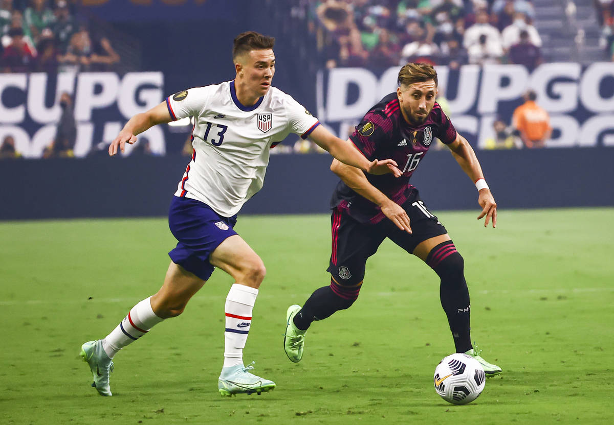United States forward Matthew Hoppe (13) battles for possession of the ball against Mexico midf ...