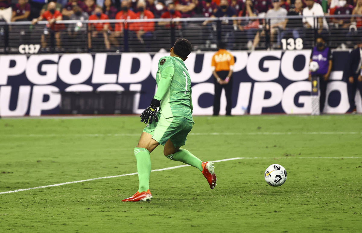United States defender Miles Robinson, not pictured, gets the ball past Mexico goalkeeper Alfre ...