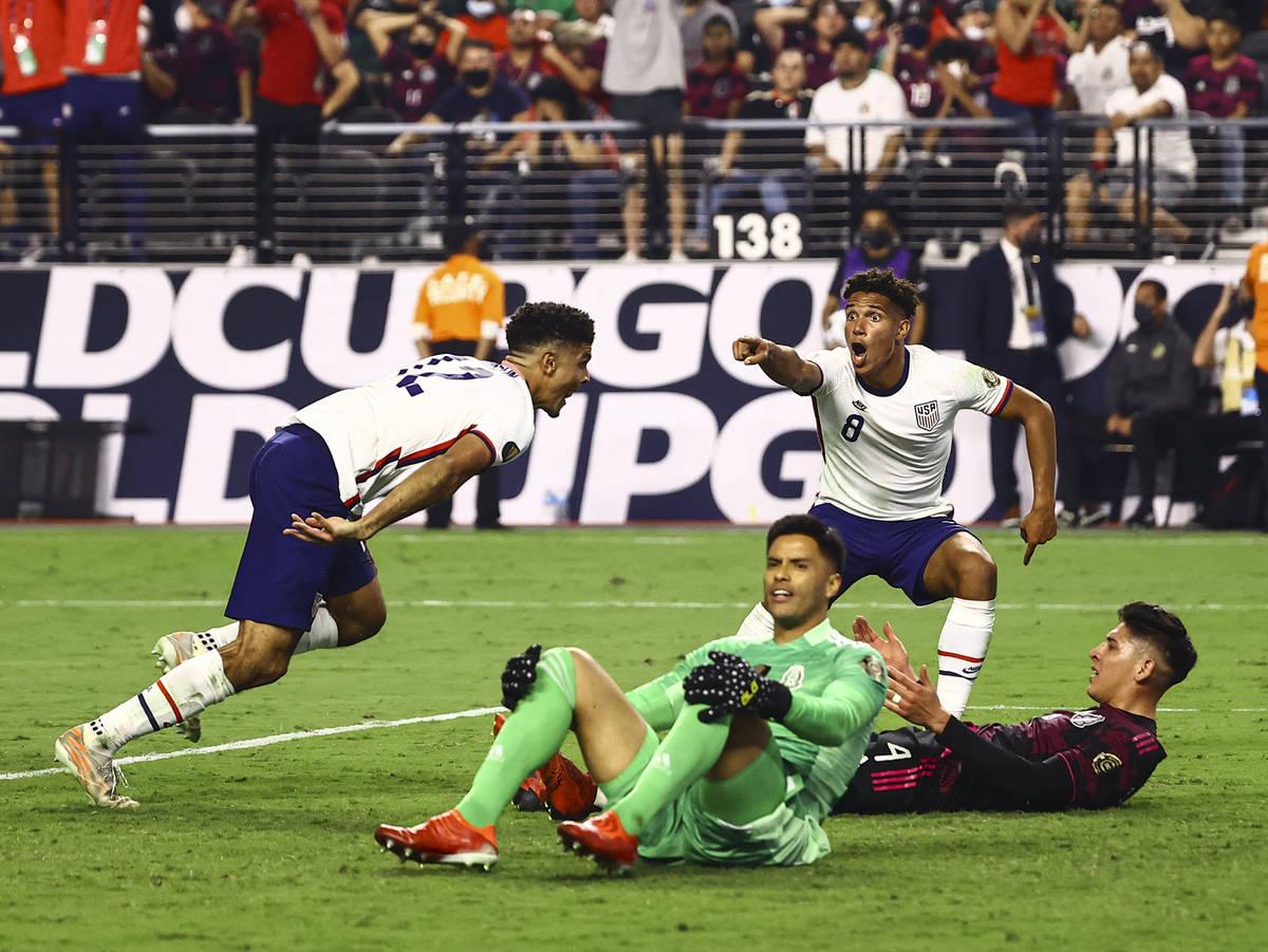 United States defender Miles Robinson, left, celebrates his goal with forward Nicholas Gioacchi ...