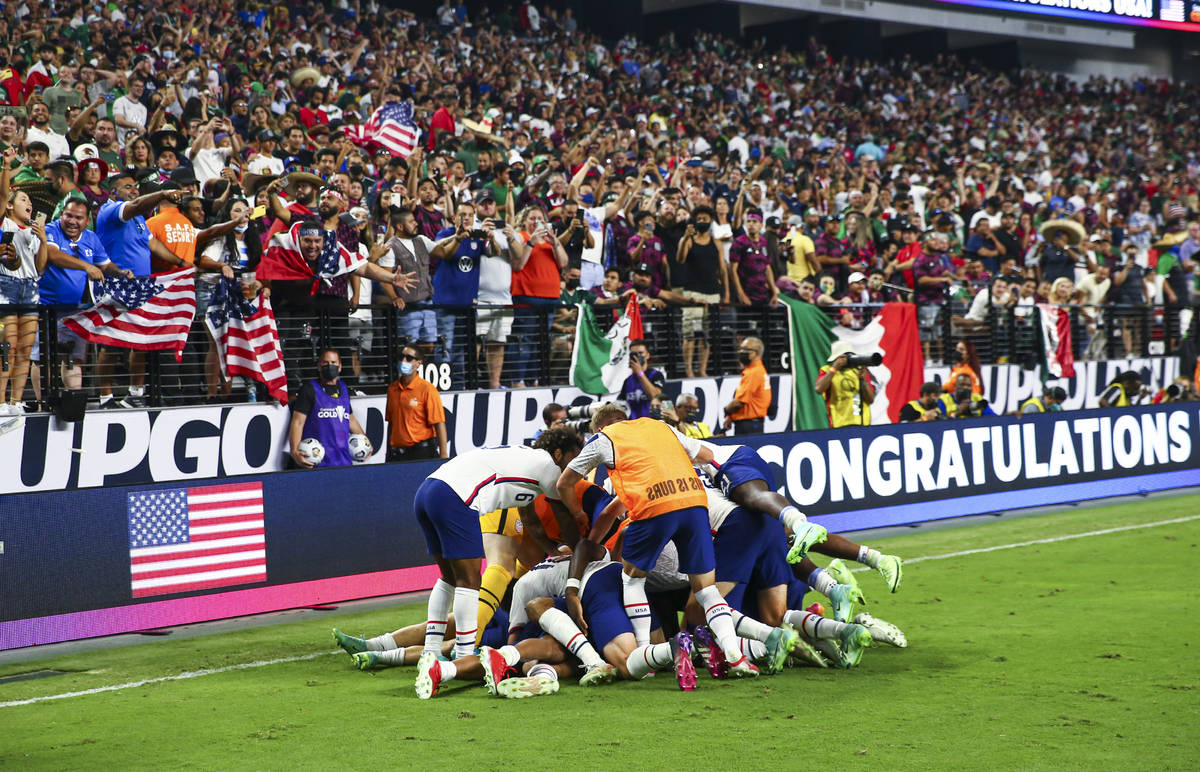 United States players celebrate after defeating Mexico 1-0 in extra time to win the Concacaf Go ...