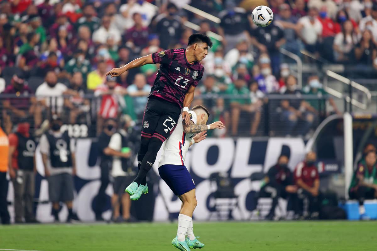 Mexico midfielder Jesus Gallardo clears the ball under pressure from United States forward Paul ...