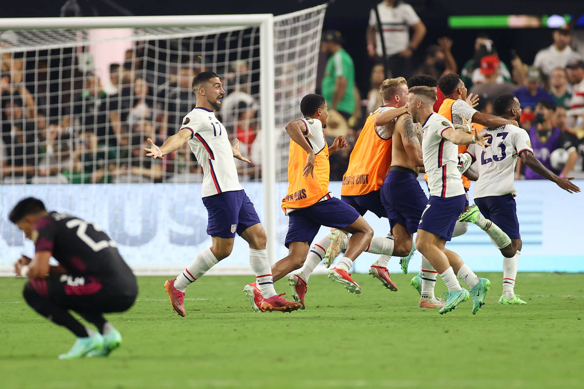 The United States celebrate their extra time win against Mexico 1-0 in the Concacaf Gold Cup fi ...