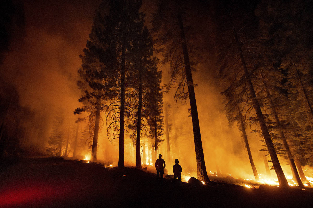 Cal Fire Capts. Derek Leong, right, and Tristan Gale monitor a firing operation, where crews se ...