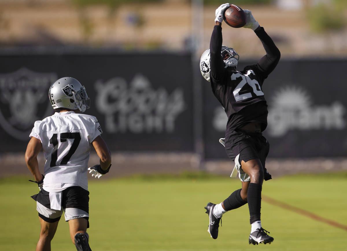 Raiders cornerback Nevin Lawson (26) makes a catch over Raiders wide receiver Willie Snead (17) ...