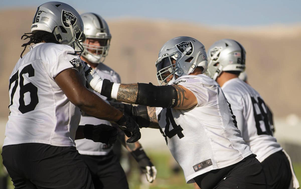 Raiders offensive guard Richie Incognito (64) blocks Raiders offensive guard John Simpson (76) ...