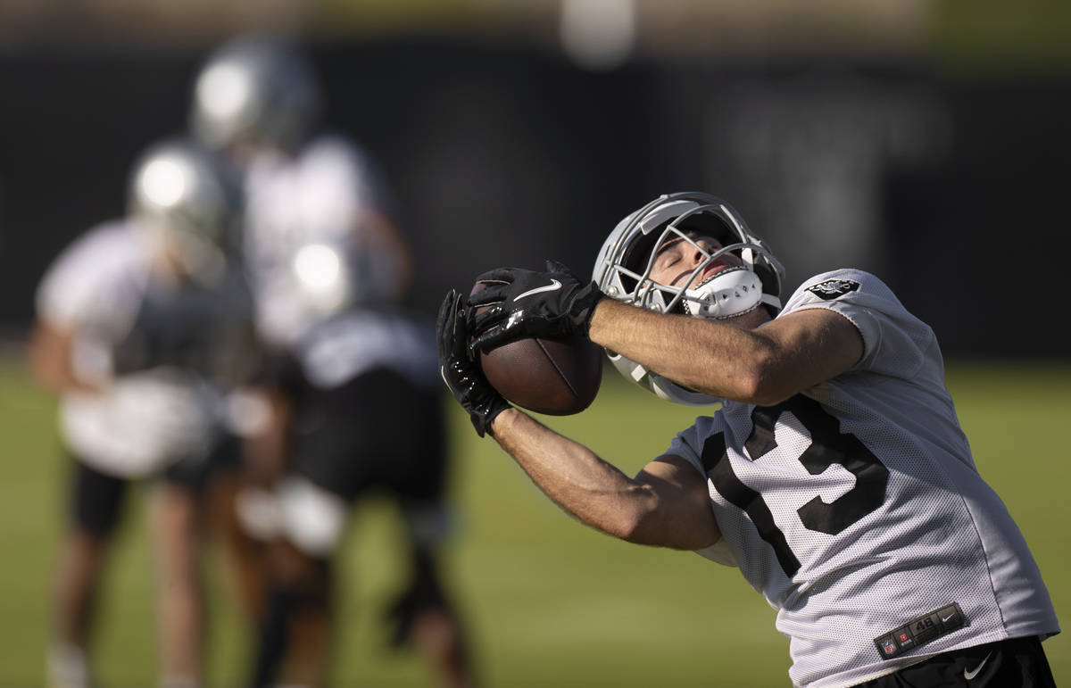 Raiders wide receiver Hunter Renfrow (13) makes a catch during drills at training camp on Monda ...