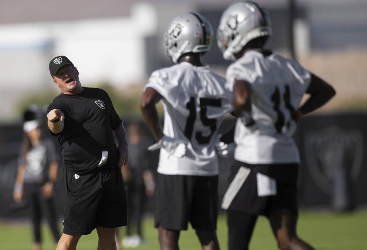 Raiders head coach Jon Gruden, left, coach up Raiders wide receiver John Brown (15) and Raiders ...