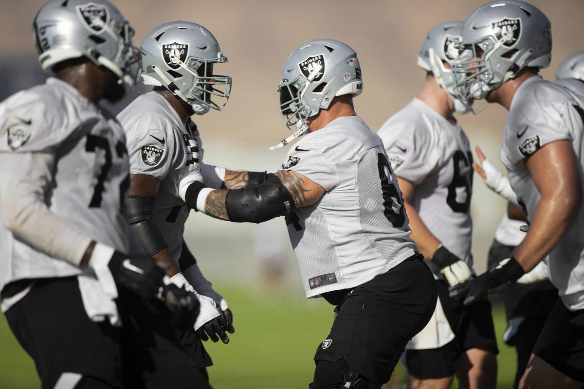 Raiders offensive guard Richie Incognito (64) runs through offensive line drills during trainin ...
