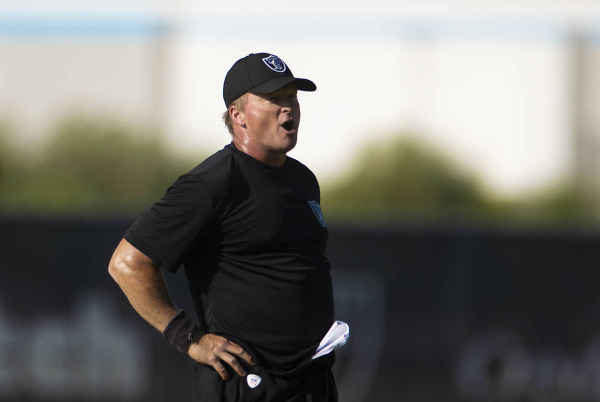 Raiders head coach Jon Gruden leads practice during training camp on Monday, Aug. 2, 2021, at R ...