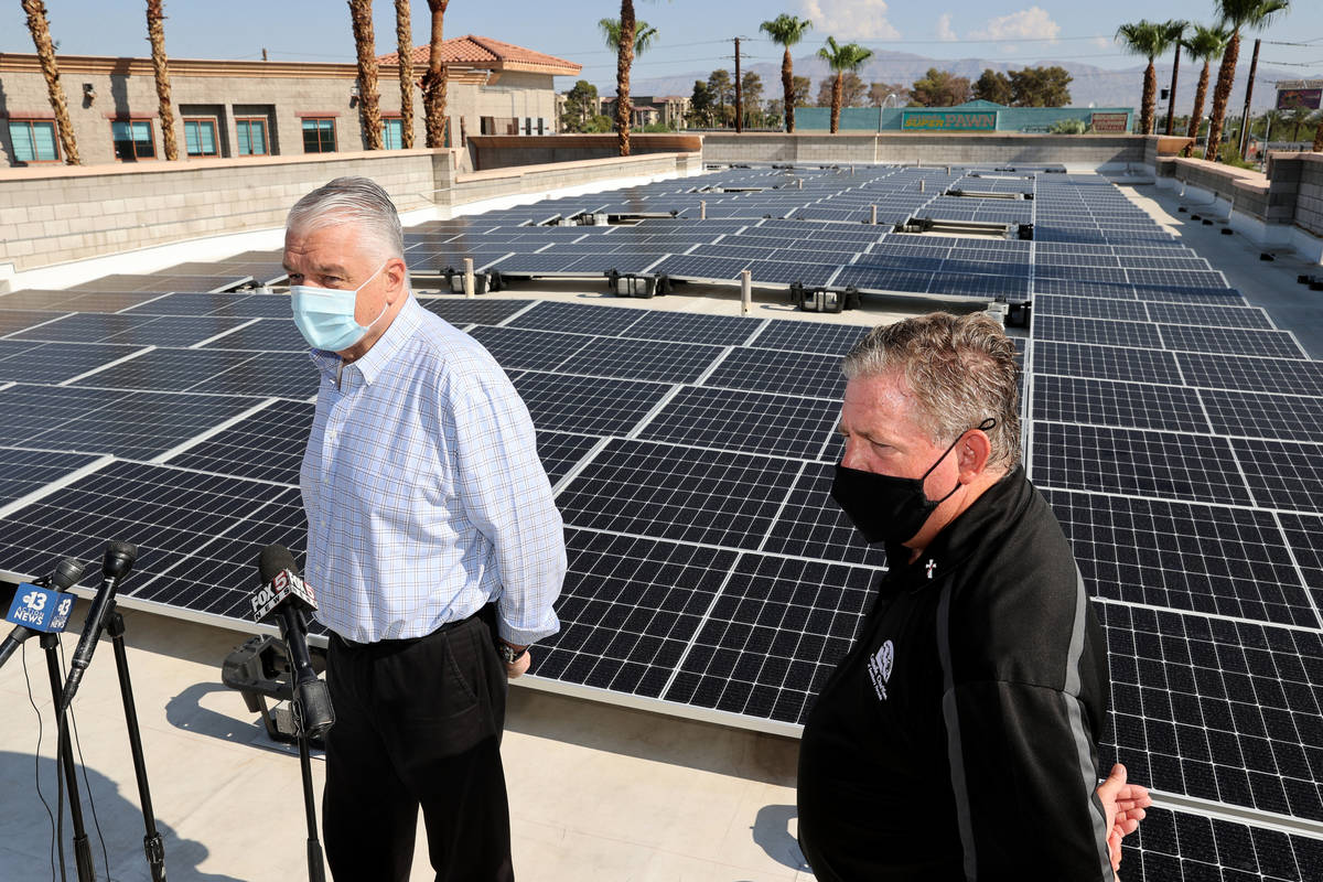Nevada Gov. Steve Sisolak, left, and Catholic Charities of Southern Nevada CEO Deacon Tom Rober ...