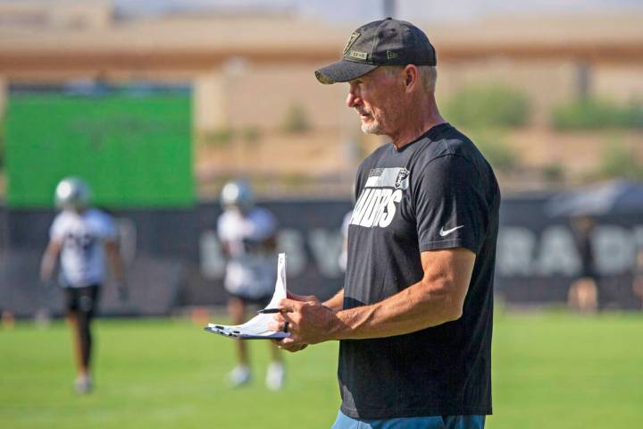 Raiders general manager Mike Mayock takes notes watching the offensive line during their NFL tr ...