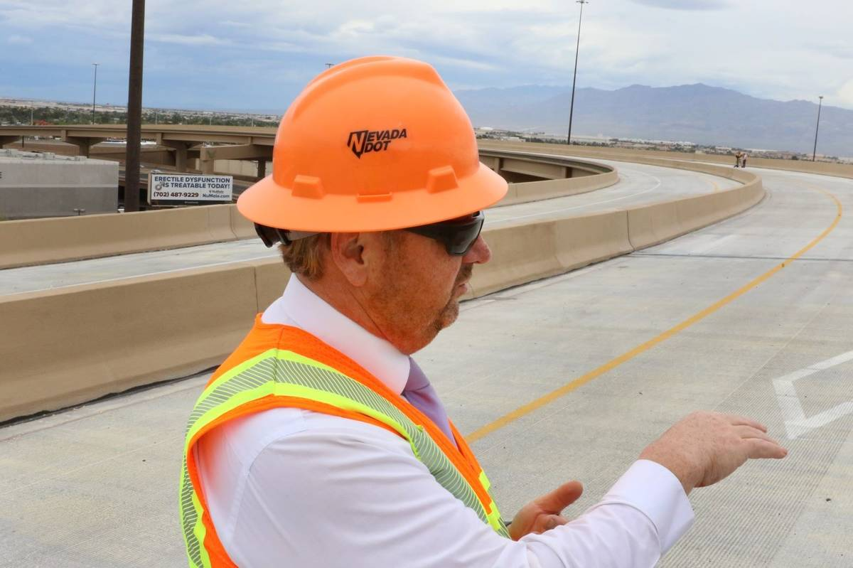 Tony Illia of NDOT addresses the media at the newly completed Project Neon HOV flyover ramp in ...