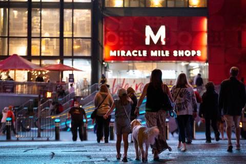 Visitors cross Las Vegas Boulevard toward Miracle Mile Shops on Monday, Nov. 16, 2020, on the L ...