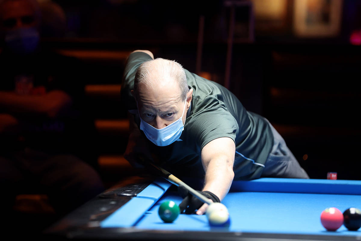 Ross Olfano of Las Vegas plays pool at Griffs Bar & Billiards in Las Vegas on the first day ...