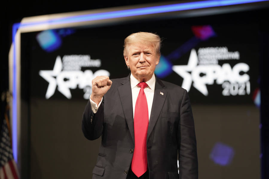 Former president Donald Trump raises his fist before speaking at the Conservative Political Act ...
