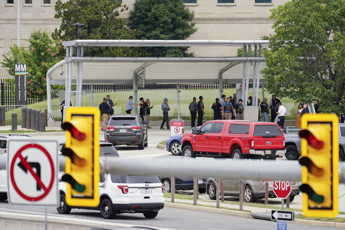Police vehicles are seen outside the Pentagon Metro area Tuesday, Aug. 3, 2021, at the Pentagon ...