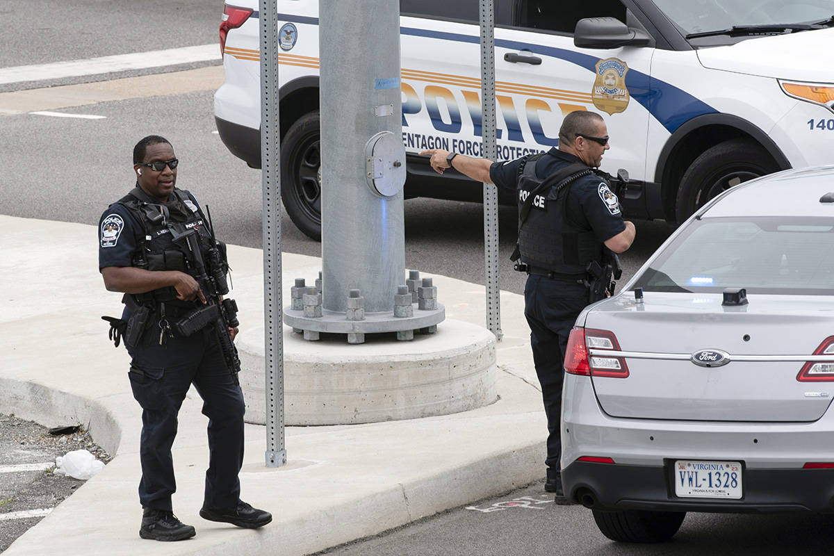 Police secure a parking lot outside the Pentagon Metro area Tuesday, Aug. 3, 2021, at the Penta ...