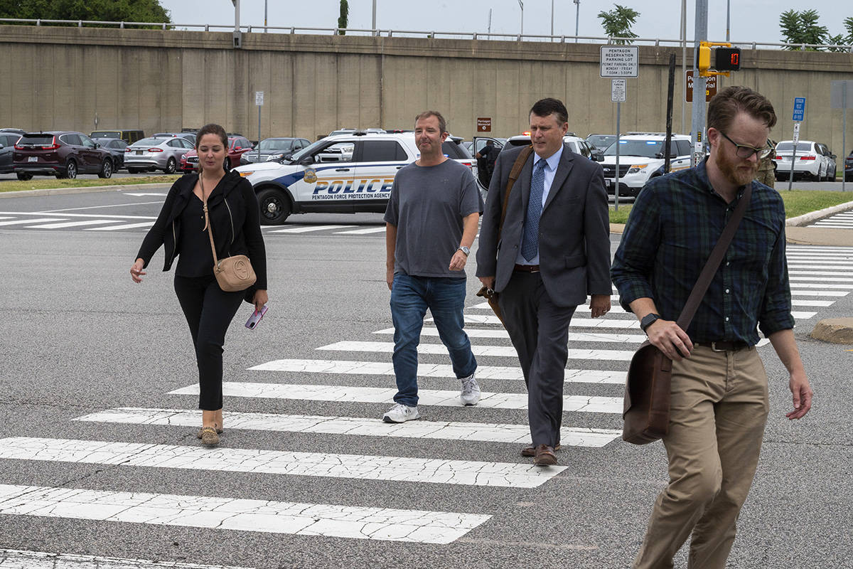 People walk away from the Pentagon, Tuesday, Aug. 3, 2021, in Washington. Gunshots were fired T ...