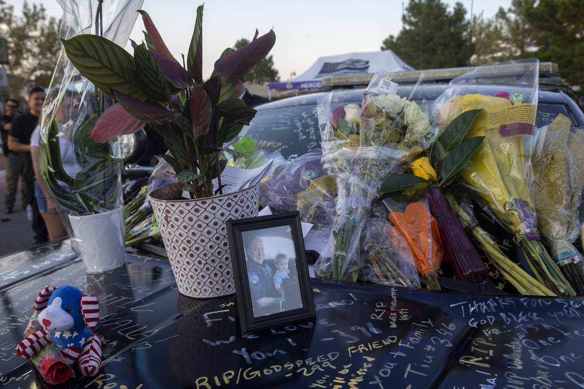Nevada Highway Patrol trooper Micah May's former squad car is adorned with photos, signatures a ...