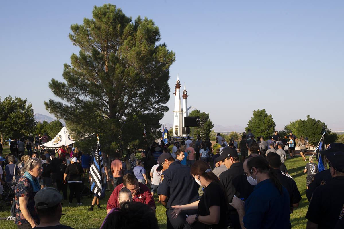 A vigil for Nevada Highway Patrol trooper Micah May takes place at Police Memorial Park on Tues ...