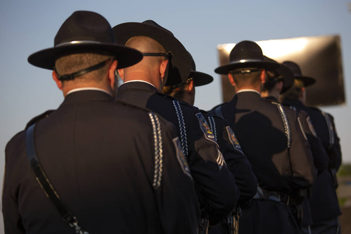 The Honor Guard attends a vigil for fallen Nevada Highway Patrol trooper Micah May at Police Me ...