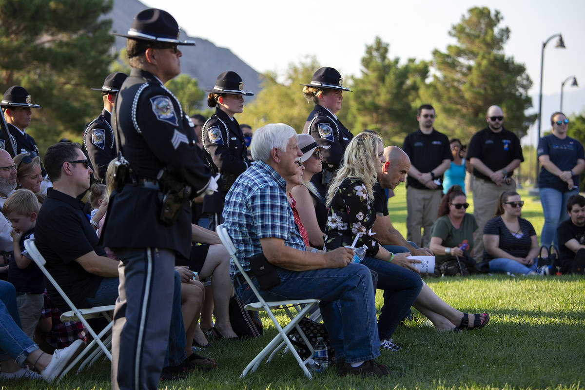 Family, friends and colleagues listen to speakers during a vigil for fallen Nevada Highway Patr ...