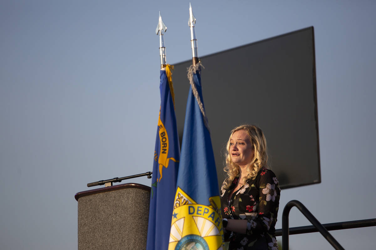 Joanna May speaks during a vigil for her husband, Nevada Highway Patrol trooper Micah May, at P ...