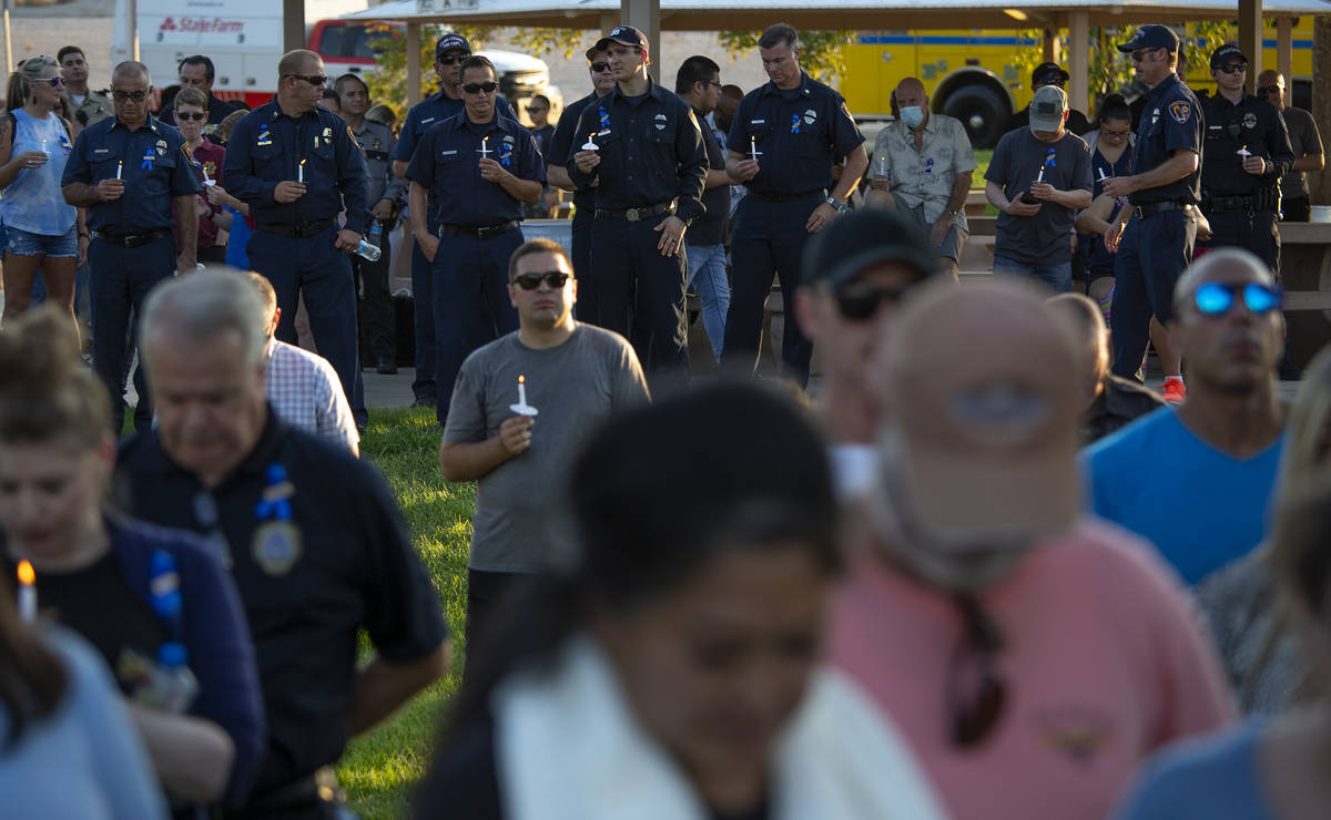 Law enforcement attends a vigil for Nevada Highway Patrol trooper Micah May at Police Memorial ...