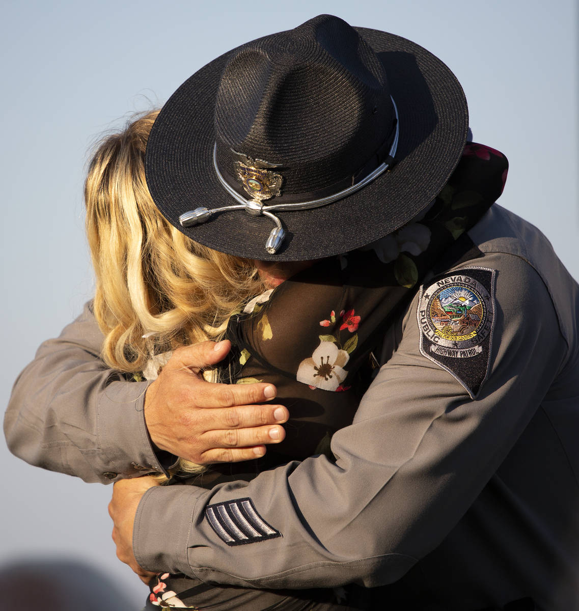 Joanna May hugs Nevada Highway Patrol Lt. Anthony Munoz after he spoke during a vigil for her h ...