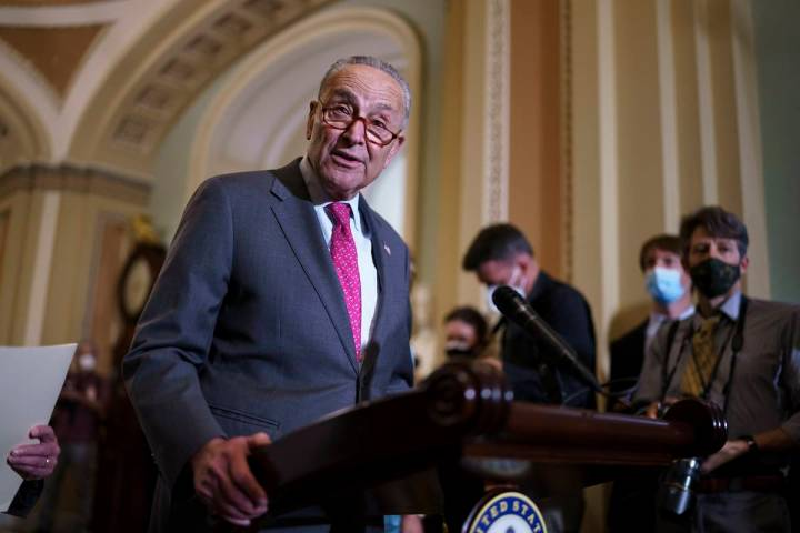 Senate Majority Leader Chuck Schumer, D-N.Y., speaks to reporters as lawmakers work to advance ...