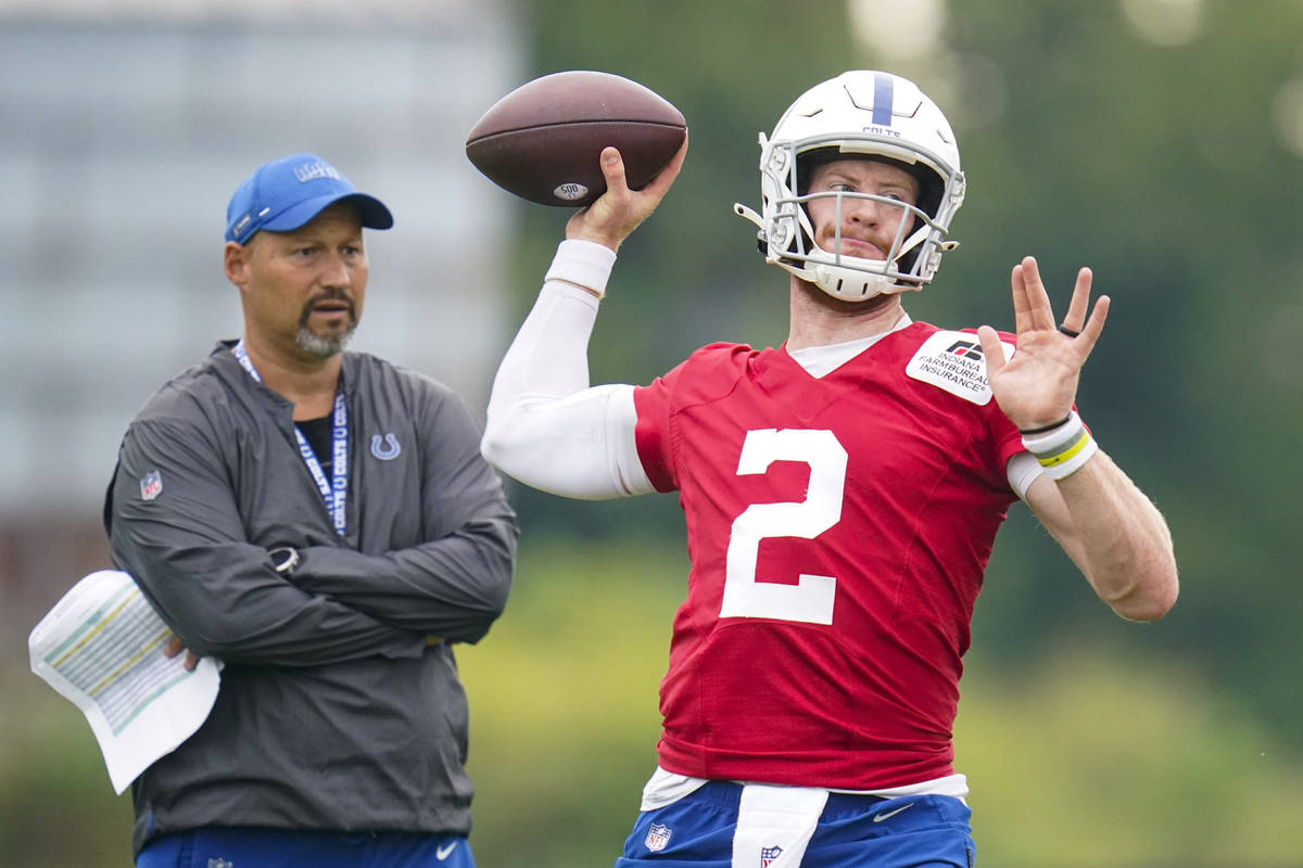 Indianapolis Colts quarterback Carson Wentz throws during practice at the NFL team's football t ...