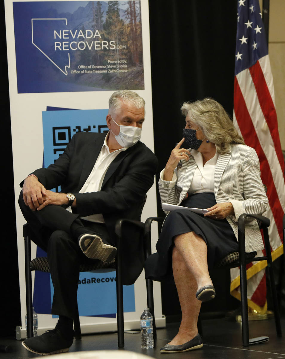 Nevada Gov. Steve Sisolak speaks to Rep. Dina Titus, D-Nev., during a kick-off event of the Nev ...