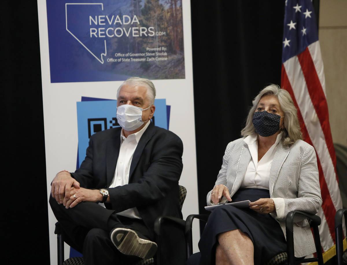 Nevada Gov. Steve Sisolak and Rep. Dina Titus, D-Nev., listen to Nevada State Treasurer Zach Co ...