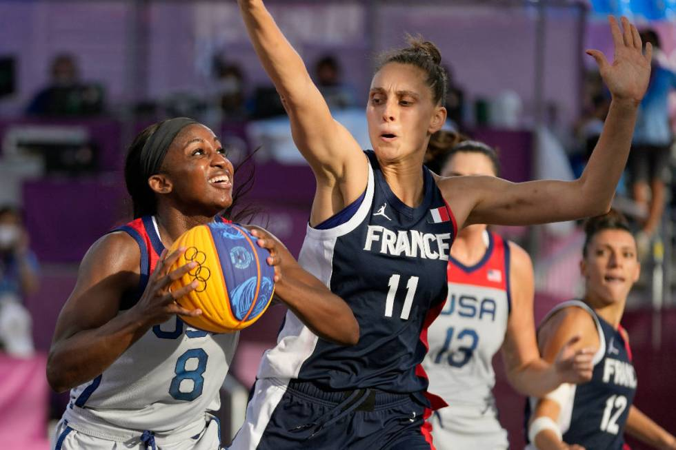 United States' Jackie Young (8) shoots implicit    France's Ana Maria Filip (11) during a women's 3-on ...