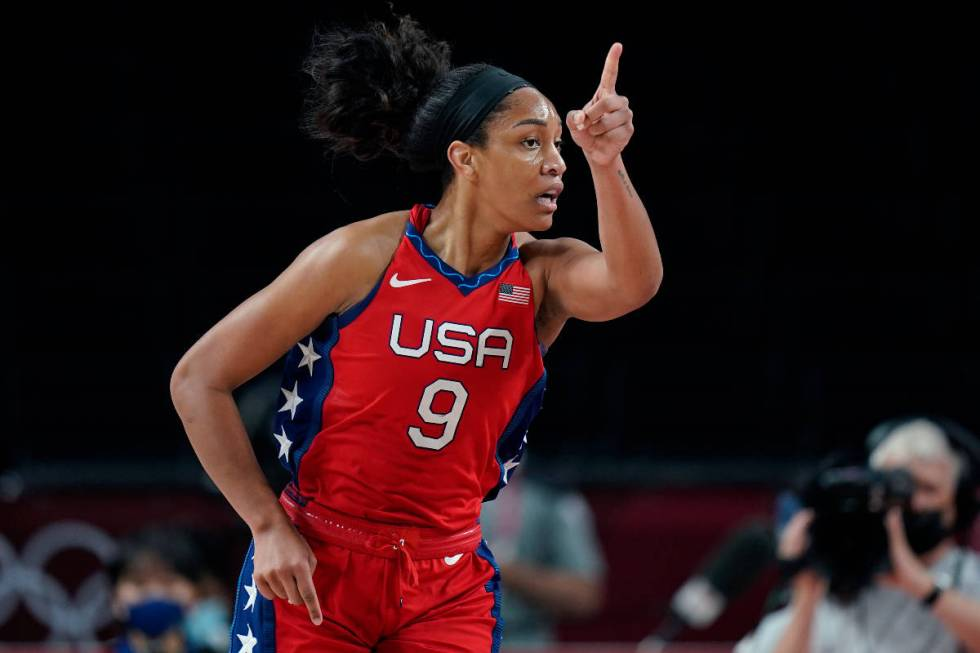 United States's A'Ja Wilson (9) reacts aft  scoring against Australia during a women's basketb ...