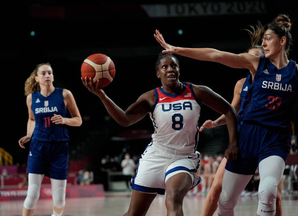 United States' Chelsea Gray (8) drives astir   Serbia's Tina Krajisnik (33) during women's baske ...
