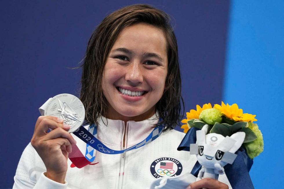 Erica Sullivan of the United States poses with metallic  medal for the women's 1500-meters freesty ...