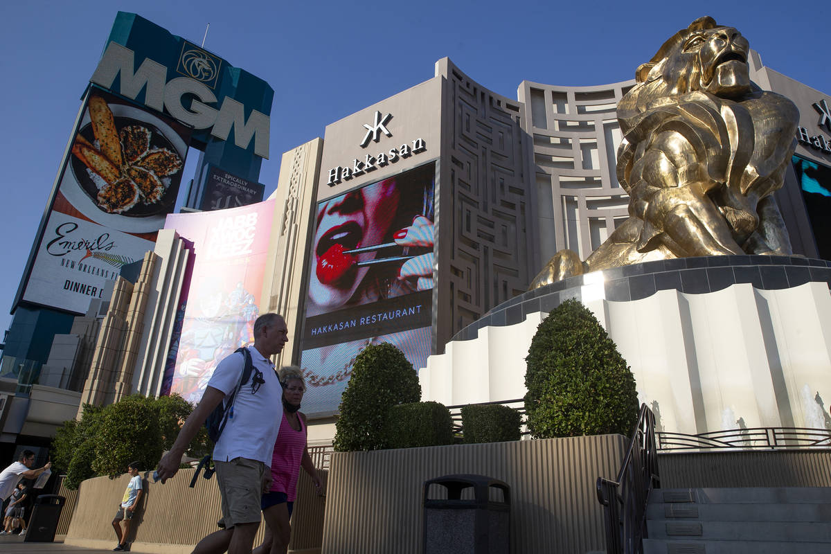 Visitors to the Las Vegas Strip pass MGM Grand on Wednesday, Aug. 4, 2021. Caesars Entertainmen ...