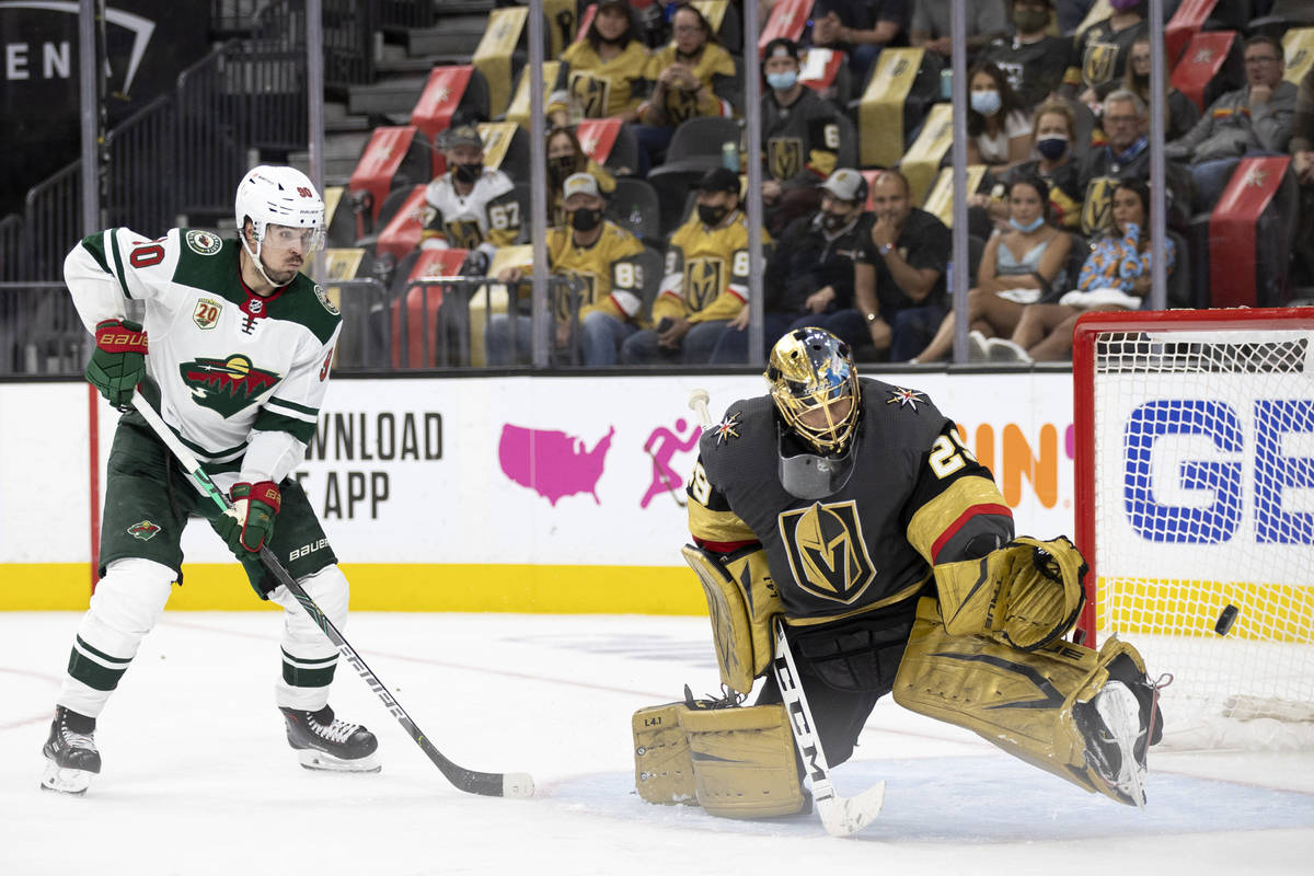 Wild center Marcus Johansson (90) watches to see if the puck goes into the net while Golden Kni ...