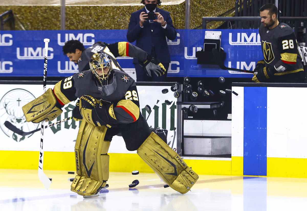 Golden Knights mgoaltender Marc-Andre Fleury warms up before Game 3 of an NHL hockey Stanley Cu ...