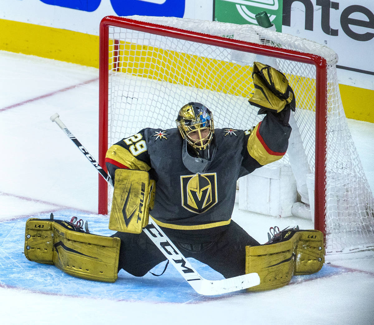 Golden Knights goaltender Marc-Andre Fleury (29) reaches up for another stop versus the Minneso ...