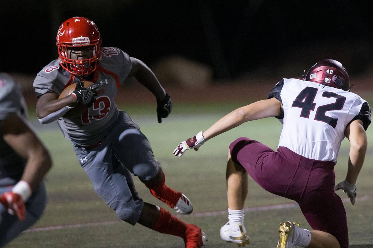 Arbor View sophomore running back D'Andre Washington (13) returns a kick past Faith Lutheran se ...
