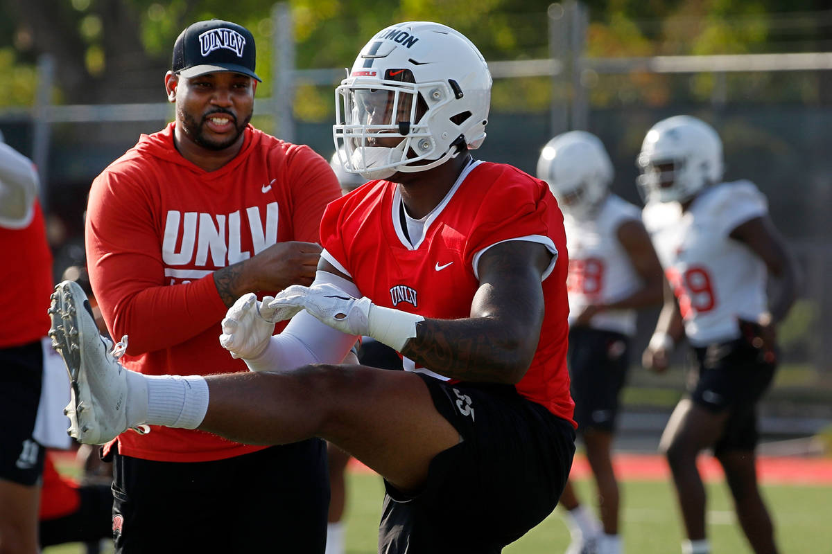 UNLV Rebels linebacker Jacoby Windmon (4), foreground, warms up during football practice in UNL ...