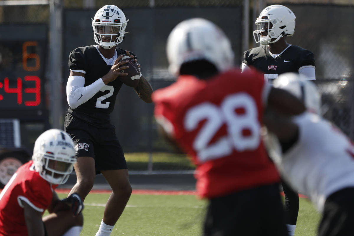 UNLV Rebels quarterback Doug Brumfield (2) looks to throw the ball during football practice in ...