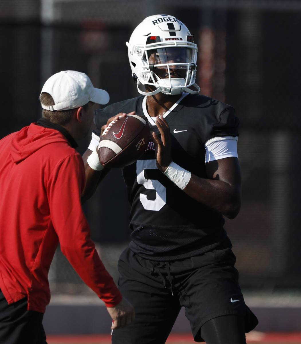 UNLV Rebels quarterback Justin Rogers (5) looks to throw the ball during football practice in U ...