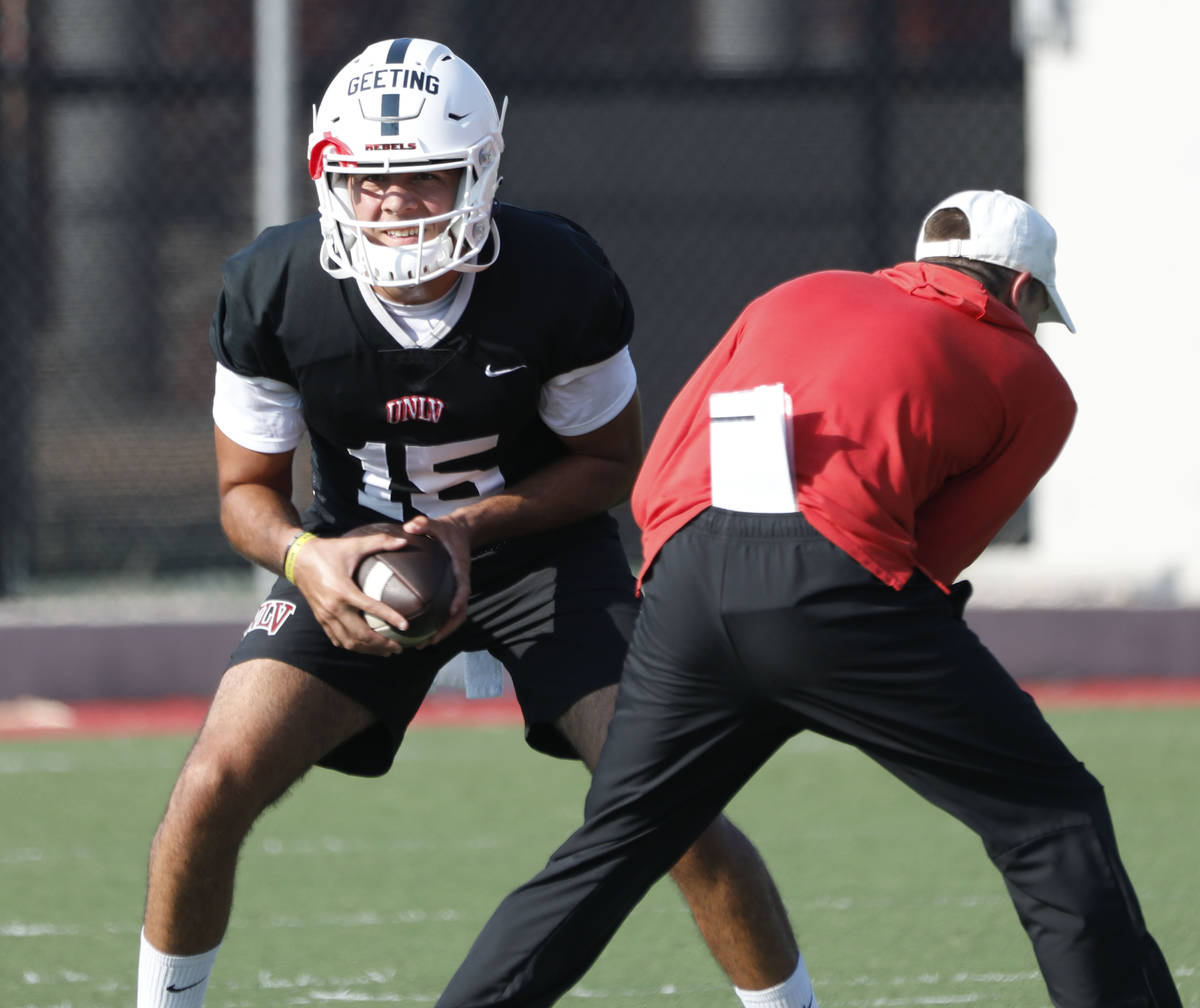 UNLV Rebels quarterback Matthew Geeting (15) looks to throw the ball during football practice i ...