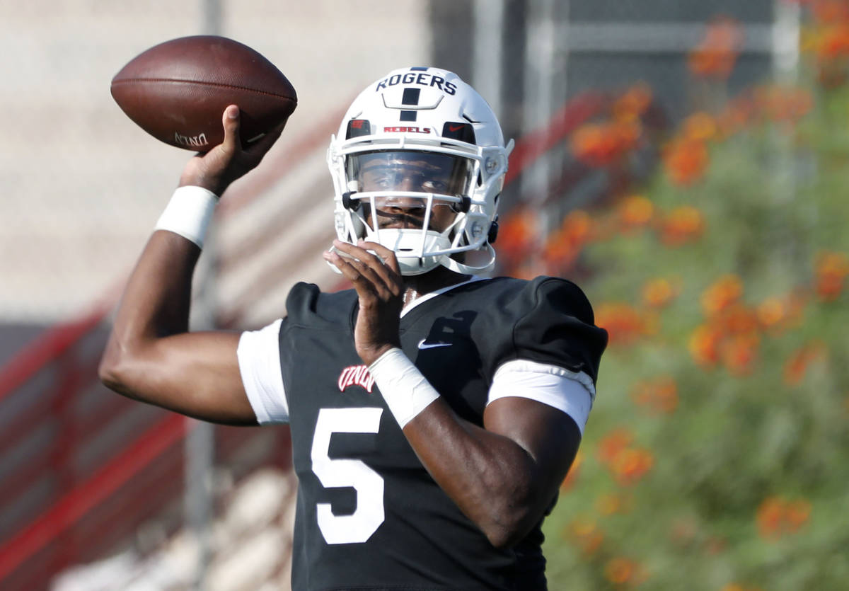 UNLV Rebels quarterback Justin Rogers (5) throws a ball during football practice in UNLV, Wedne ...